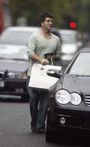 Pics of Simon Cowell shopping in Sloane Street, West London.