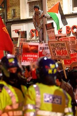 From Paul Burgman/PressphotosUK.com  Demonstrators in Kensington High Street near the Israelli Embassy.