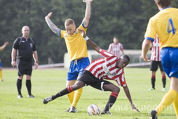 From Paul Burgman@PressPhotos-uk.com   28/09/13  Guildford City FC v Taunton Town FC @ Guildford Spectrum. City's Laurie WALTERS & Taunton's Rob NORRISH Pic: Paul Burgman