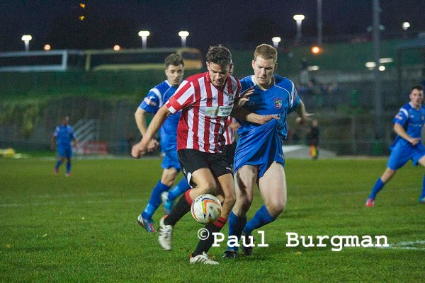 GCFC Striker PAT COX gives defender a Wedgie.