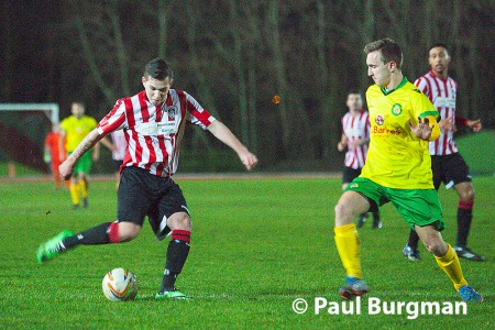 22/01/2014 Guildford City FC v Godalming Town FC at the Spectrum. A competitive match that saw three sendings off. City's SAM SPENCER tests the keeper  [Pic Paul Burgman]