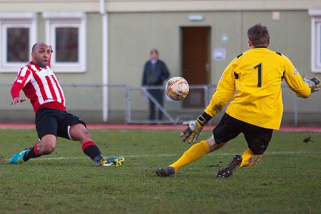 1/03/2014 Guildford City v Bishops Cleeve at the Spectrum.  A 6 pointer at the bottom of the table clash. Shortly after scoring LANCE BANTON-BROWN nearly doubled City's lead [Pic Paul Burgman]
