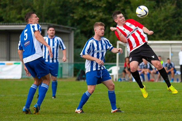 6/09/2014 Guildford City FC v Chertsey Town FC. City's Sam SPENCER heads just over the bar