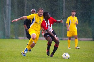 11/10/2014 Guildford City v Frimley Green at the Spectrum. City's Edward Boateng fouled