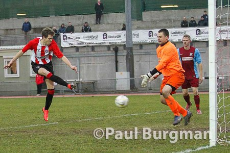 7/02/2015 Guildford City v Horley Town. City's Anthony BAKER scores