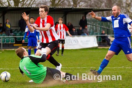 21/03/2015. Frimley Green v Guildford City FC. City's Anthony Baker stopped by Frimley's keeper