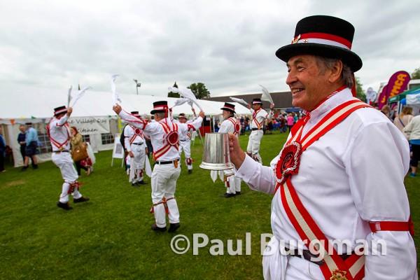 13/06/2015. Ashtead Village Day. Morris Men lead the entertainment