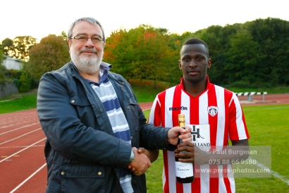 22/10/2016. Guildford City v North Greenford United. City's Mario EMBALA receives man of the match