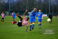 10/12/2016. Guildford City v Sutton Common Rovers. City's Shawn LYLE tests the keeper with an overhead shot on goal