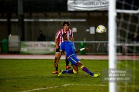 10/12/2016. Guildford City v Sutton Common Rovers. City's Alex ROSE shoots