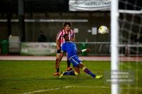 10/12/2016. Guildford City v Sutton Common Rovers. City's Alex ROSE shoots