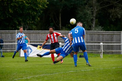 2008/2017 Guildford City FC v Camberley Town. FA Cup. City 4-0 Winners. City's Nathaniel Williams scores City's Fourth with a competitor for goal of the season.