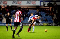 27/11/2017. QPR v Brentford. Action from the SkyBet Championship. QPRÕs Jake BIDWELL debags Brentford's Sergi CANOS