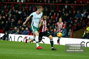 16/12/2017. Brentford FC v Barnsley FC. SkyBet Championship Football Action from Griffin Park Brentford's Neal MAUPAY battles