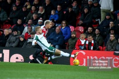 16/12/2017. Brentford FC v Barnsley FC. SkyBet Championship Football Action from Griffin Park Brentford's Sergi CANOS battles