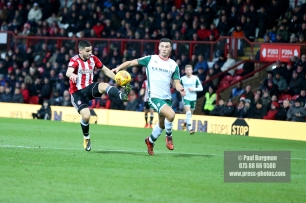 16/12/2017. Brentford FC v Barnsley FC. SkyBet Championship Football Action from Griffin Park Brentford's Neal MAUPAY