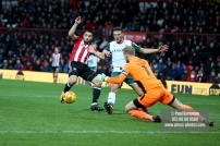 16/12/2017. Brentford FC v Barnsley FC. SkyBet Championship Football Action from Griffin Park Brentford's Neal MAUPAY's shot blocked by keeper