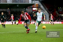 16/12/2017. Brentford FC v Barnsley FC. SkyBet Championship Football Action from Griffin Park Brentford's Romaine SAWYERS shoots