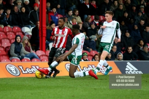 16/12/2017. Brentford FC v Barnsley FC. SkyBet Championship Football Action from Griffin Park Brentford's Josh CLARKE battles