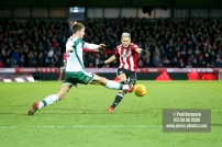 16/12/2017. Brentford FC v Barnsley FC. SkyBet Championship Football Action from Griffin Park Brentford's Sergi CANOS shoots