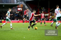 16/12/2017. Brentford FC v Barnsley FC. SkyBet Championship Football Action from Griffin Park Brentford's Yoann BARBET's shot nearly deflected in by Brentford's Neal MAUPAY
