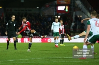 16/12/2017. Brentford FC v Barnsley FC. SkyBet Championship Football Action from Griffin Park Brentford's Yoann BARBET shoots