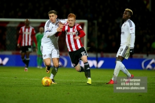 02/12/2017 Brentford v Fulham Action from the SkyBet Championship. FulhamÕs Tom CAIRNEY & Brentford's Ryan WOODS battle