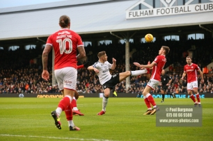 23/12/2017. Fulham v Barnsley. Action from the SkyBet Championship at Craven Cottage. FulhamÕs Tom CAIRNEY battles