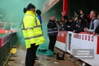 27/01/2018. Brentford FC v Norwich City. SkyBet Championship Match Action from Griffin Park. Flare thrown after Norwich score