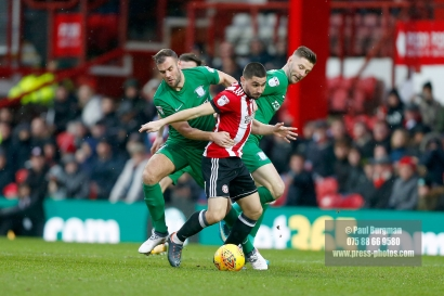 10/02/2018. Brentford v Preston North End. SkyBet Championship Match Action from Griffin Park. Brentford's Neal MAUPAY battles