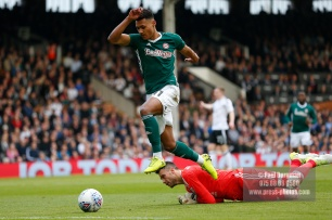 14/04/2018. Fulham v Brentford. SkyBet Championship Action from Craven Cottage. Brentford's Ollie WATKINS & FulhamÕs Goalkeeper Marcus BETTINELLI