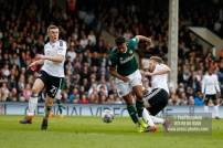 14/04/2018. Fulham v Brentford. SkyBet Championship Action from Craven Cottage. Brentford's Ollie WATKINS battles with Fulham's Tim REAM