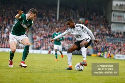 14/04/2018. Fulham v Brentford. SkyBet Championship Action from Craven Cottage. Brentford's John EGAN & FulhamÕs Ryan SESSEGNON