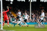 14/04/2018. Fulham v Brentford. SkyBet Championship Action from Craven Cottage. FulhamÕs Goalkeeper Marcus BETTINELLI tips over Brentford's Yoann BARBET's header