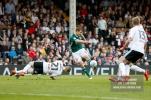 14/04/2018. Fulham v Brentford. SkyBet Championship Action from Craven Cottage. Brentford's Andreas BJELLAND shoots & Fulham's Matt TARGETT attempts to block