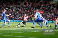 07/04/2018. Brentford FC v Ipswich Town, SkyBet Championship Action from Griffin Park Brentford's Neal MAUPAY shoots