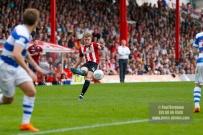 21/04/2018. Brentford v Queens Park Rangers SkyBet Championship Action from Griffin Park. Brentford's Lewis MACLEOD crosses
