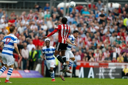 21/04/2018. Brentford v Queens Park Rangers SkyBet Championship Action from Griffin Park. QPR's Massimo LUONGO & Brentford's Romaine SAWYERS