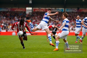 21/04/2018. Brentford v Queens Park Rangers SkyBet Championship Action from Griffin Park. QPR's Jamie MACKIE & Brentford's Romaine SAWYERS