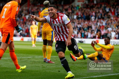 Brentford's Neal Maupay celebrates first goal during the EFL Sky Bet Championship match between Brentford and Wigan Athletic at Griffin Park, London, England on 15 September 2018.