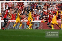 Brentford's Neal Maupay scores second during the EFL Sky Bet Championship match between Brentford and Wigan Athletic at Griffin Park, London, England on 15 September 2018.