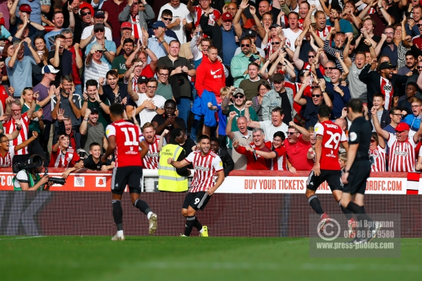 Brentford's Neal Maupay celebrates second during the EFL Sky Bet Championship match between Brentford and Wigan Athletic at Griffin Park, London, England on 15 September 2018.