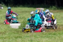 22/06/2019 From Paul Burgman/Press-Photos.com. Action from the British Lawn Mower Racing from Newdigate, Surrey. . Race Winner Ian Tanswell (56) leads Peter Sque (32) and Stuart Johnson (8)