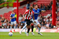 03/08/2019 From Paul Burgman/Press-Photos.com. Brentford v Birmingham City in the Championship. Brentford's Defender Julian Jeanvier & CityÕs Lukas Jutkiewicz