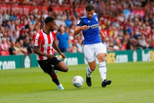 03/08/2019 From Paul Burgman/Press-Photos.com. Brentford v Birmingham City in the Championship. CityÕs Defender Maxime Colin & Brentford's Defender Rico Henry