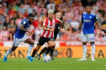 03/08/2019 From Paul Burgman/Press-Photos.com. Brentford v Birmingham City in the Championship. CityÕs Midfielder Jacques Maghoma charges whilst CityÕs Midfielder David Davis watches on
