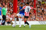 03/08/2019 From Paul Burgman/Press-Photos.com. Brentford v Birmingham City in the Championship. CityÕs Midfielder David Davisn & Brentford's Defender Rico Henry